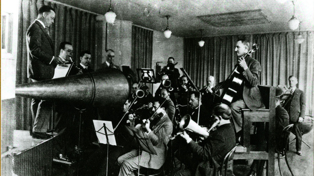 The Victor Orchestra crowds around an enormous horn for an early acoustical recording session. (courtesy of Recorded Sound Section, MBRS Division, Library of Congress)