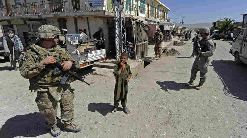 In this photo provided by ISAF Regional Command (South), members of Provincial Reconstruction Team Zabul and 1st Stryker Brigade Combat Team, 25th Infantry Division, make their way to the Zabul Juvenile Detention Facility on Wednesday in Qalat, Afghanistan. The effect of al-Qaida leader Osama bin Laden's death on the Afghan insurgency is yet to be seen.