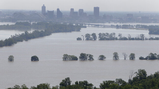 Memphis: Downtown buildings are seen in the distance as the swollen Mississippi River spreads out in the foreground. (Tuesday, May 10, 2011.)