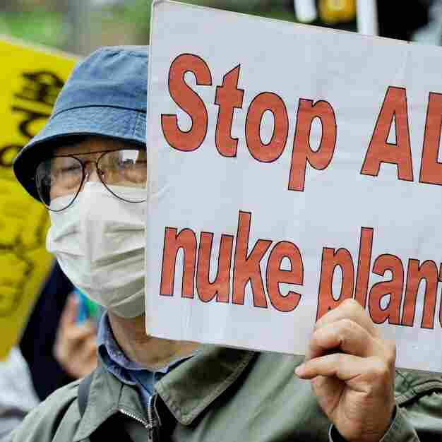 A man holds a placard during a march denouncing the use of nuclear  plants and power during a demonstration in Tokyo on May 1.