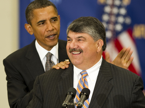 President Obama pats AFL-CIO President Richard Trumka on the back before speaking at the AFL-CIO Executive Council Meeting in Washington last August. Trumka said recently that unions need to start demanding accountability from their allies.