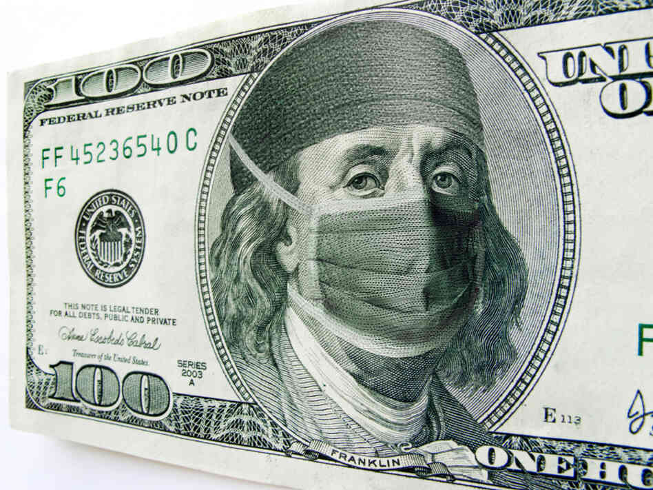 Ben Franklin wears a surgical mask on a $100 bill.