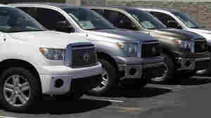 Toyota Tundra trucks are lined up at an Arizona dealership in April, when the automaker recalled about 51,000 of the vehicles.