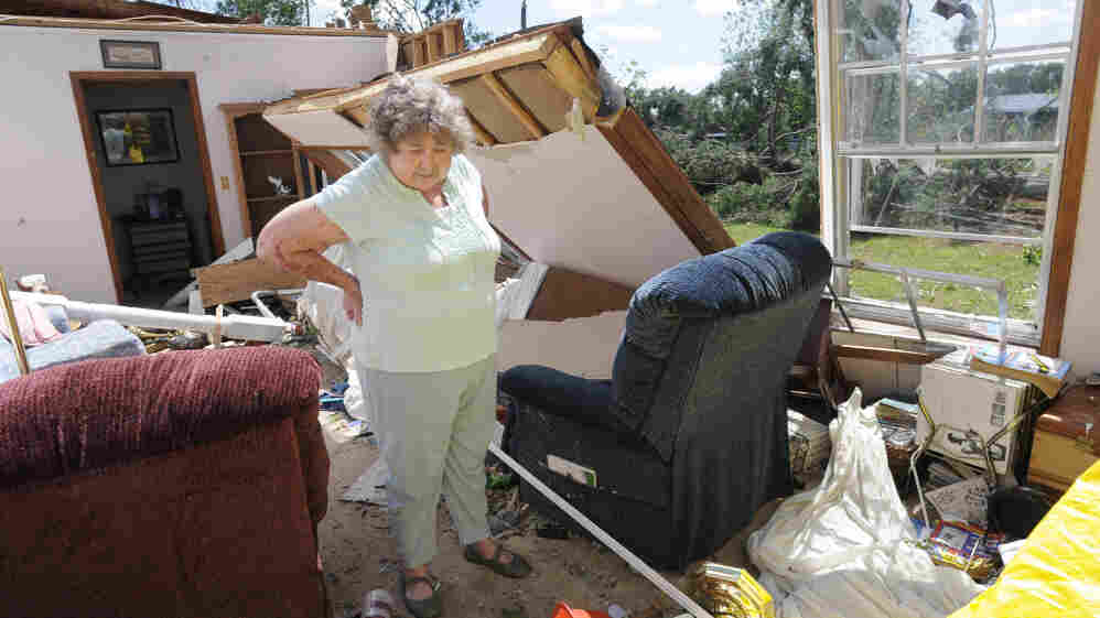 April 28: Norma Carpenter, 71, stands in the wreckage of her living room in Catoosa County, Ga. A tornado swept through the day before.