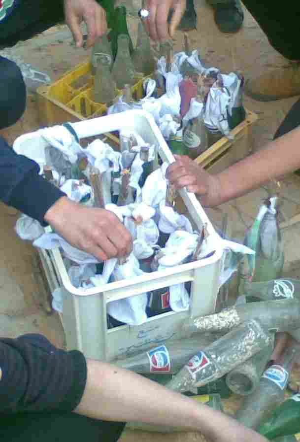 A group of Libyans make Molotov cocktails in Tripoli.