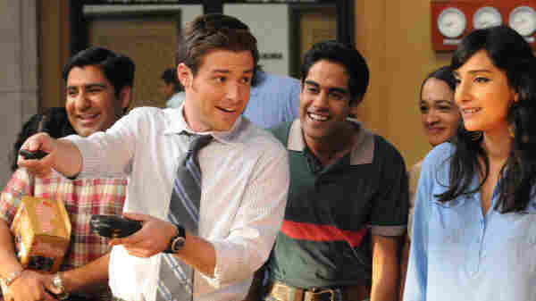 Ben Rappaport as Todd Dempsy and Sacha Dhawan as Manmeet on NBC's Outsourced.