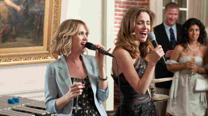 Kristen Wiig (left) breaks the tired mold of summer wedding comedies with Bridesmaids, where her character grapples with a rival (Rose Bryne) without the genre's typically inconceivable levels of earnestness.