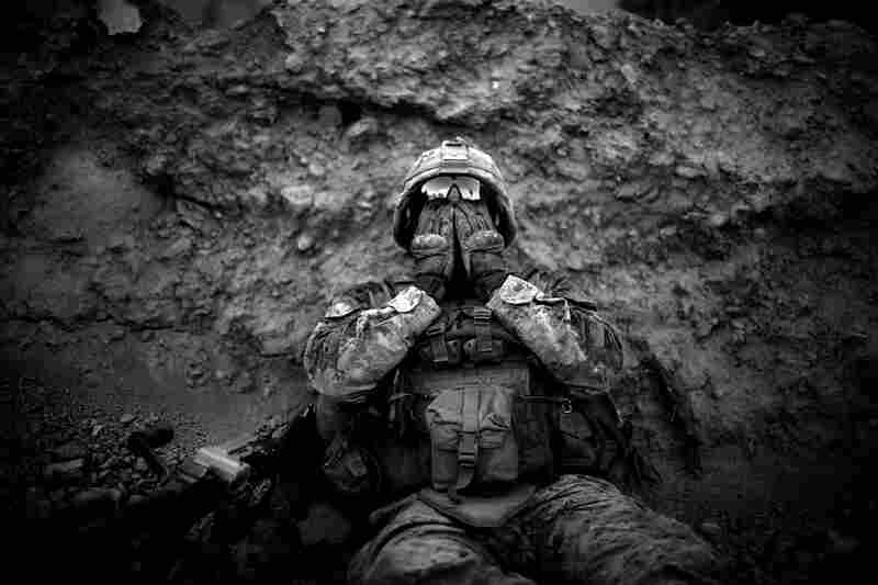 Lance Cpl. Anthony Espinoza wipes the salt and sweat out of his eyes at the end of a daylong patrol. The 100-degree temperatures and humidity of the flooded farm fields make walking and patrolling in the area a daily battle.