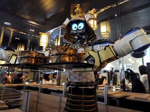 Are robot waiters in our future in the U.S.? Here, a robot holds a tray of food at a restaurant in Bangkok.