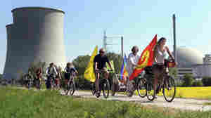"""Protesters ride their bikes and hold flags reading """"Nuclear power? No thanks"""" during a demonstration at the nuclear power plant of Biblis in Germany on April 25. Germany canceled plans to build new plants in the aftermath of the nuclear disaster in Japan."""