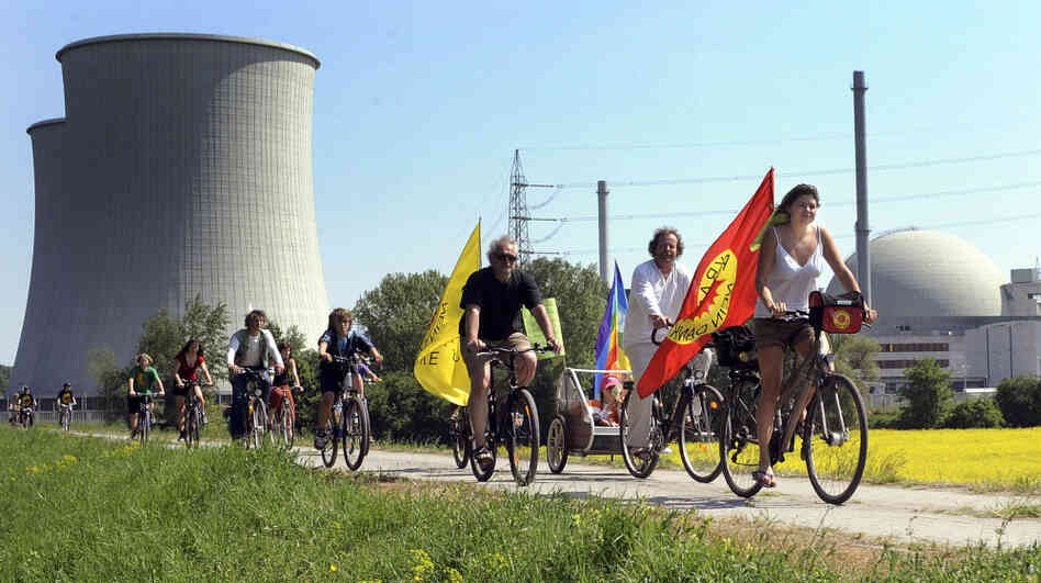 "Protesters ride their bikes and hold flags reading ""Nuclear power? No thanks"" during a demonstration at the nuclear power plant of Biblis in Germany on April 25. Germany canceled plans to build new plants in the aftermath of the nuclear disaster in Japan."