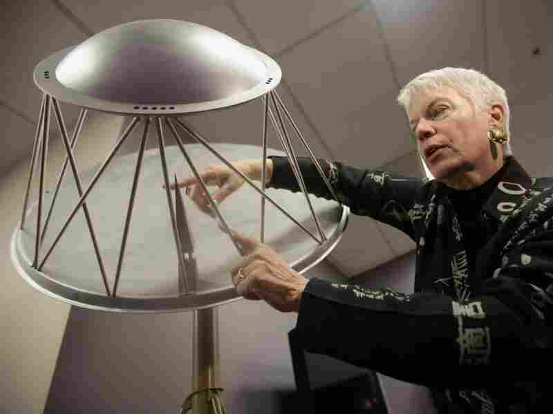 Jill Tarter, director of the Center for SETI Research in Mountain View, Calif., describes a model telescope in April.