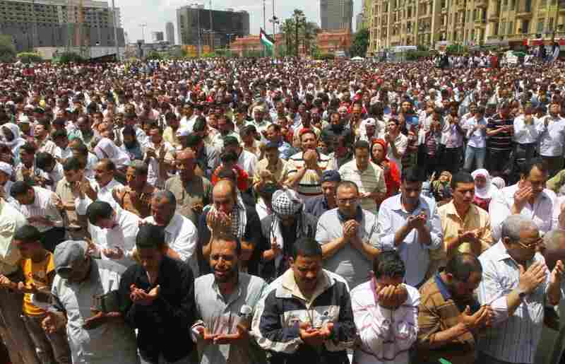 Egyptians say Friday prayers at a rally in Cairo's Tahrir Square on Friday. The rally called for national unity after attacks on Egyptian churches.