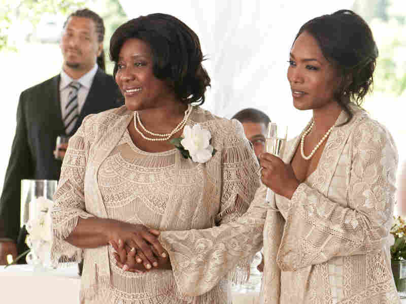 Loretta Devine (left) and Angela Bassett play dueling mothers in Jumping The Broom.