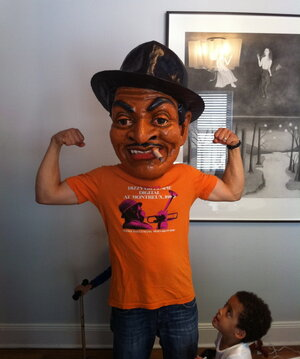 Yes, that's Jason Moran — with one twin son at his side and another (obscured) behind him — in a Fats Waller mask made by artist Didier Civil.