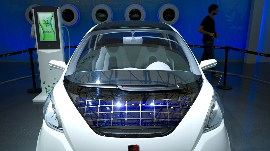 Green car technology is still in its infancy in China, and there's little uniformity in the way of infrastructure to support the vehicles, like this concept car with solar panels, made by Roewe, seen at the Shanghai auto show. (AFP/Getty Images)