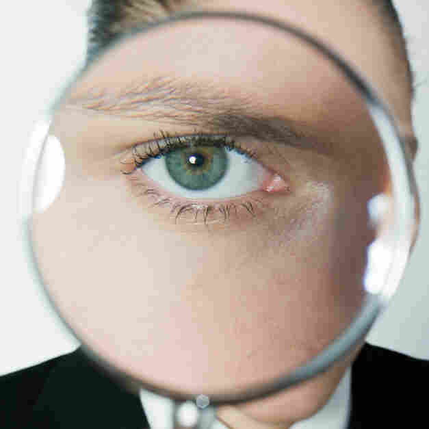 Eye in a magnifying glass