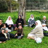 An Algerian family enjoys a picnic in Tipaza, a vacation town about 40 miles from Algiers. Many Algerian women say that wearing  the veil is not an issue in their emancipation; what matters is their  family situation, which is influenced by a strict code that governs  marriage and family life.