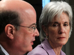 Health and Human Services Secretary Kathleen Sebelius listens as Social Security Administration Commissioner Michael Astrue speaks during a Friday news briefing on Social Security and Medicare.