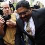 Raj Rajaratnam leaves court after he was convicted on fraud and conspiracy charges Wednesday in New York. That conviction has energized the government's campaign against insider trading.