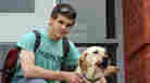Service Dogs Teach Educators About Disabilities