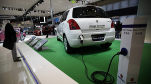Expanding the hybrid and electric car market in China will be a challenging task, experts say. There's not yet a robust infrastructure to support the environmentally friendly vehicles, like the Suzuki Swift Range Extender Hybrid, seen at the Shanghai auto show April 20.