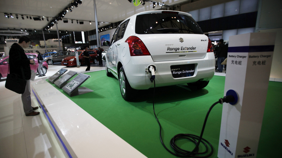 Expanding the hybrid and electric car market in China will be a challenging task, experts say. There's not yet a robust infrastructure to support the environmentally friendly vehicles, like the Suzuki Swift Range Extender Hybrid, seen at the Shanghai auto show April 20. (AP)