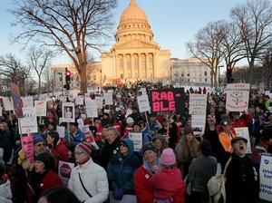 Protesters rally outside the State Capitol in Madison, Wis. following a vote which essentially eliminated collective bargaining rights for public union workers except on wage issues. Thousands of demonstrators took over the Capitol following the Senate vote on the bill which passed with no Democrats present.