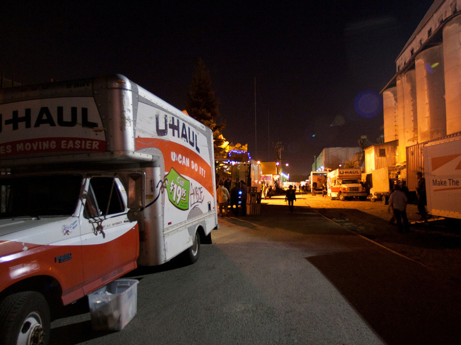 Box trucks line up as setup begins for the Lost Horizon Night Market in Oakland, Calif.