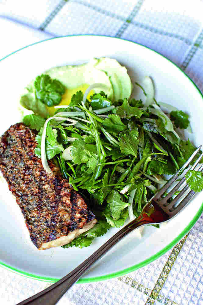 For Cod and Country pairs inventive combinations of fish and fresh vegetables and suggests substitutes for over-harvested fish species. Above, wild striped bass with cilantro-onion salad and yogurt-avocado puree. Click here for this and other recipes.