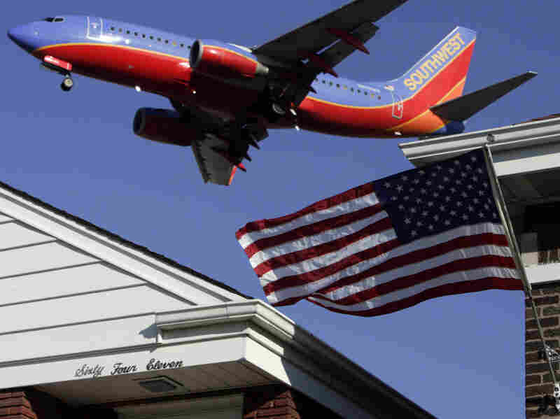 A plane flies over a Chicago neighborhood as it lands at Midway Airport. A recent World Health Organization study reports noise pollution can be a health threat.