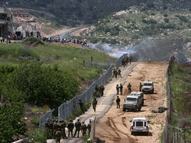 Palestinian protesters from Syria infiltrate the Israel-Syria border on May 15, 2011 near the Druze village of Majdal Shams, Israel.