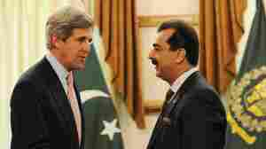 U.S. Sen. John Kerry (left) shakes hands with Pakistani Prime Minister Yousuf Raza Gilani during a meeting in Islamabad on Monday.