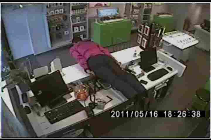 planking on an office desk.