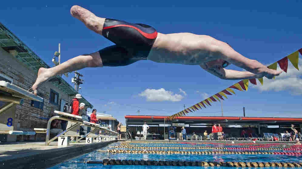 Nicholas Gibbons, a single amputee with the British Royal Marines team, takes off from the blocks during practice Feb. 21 in Camp Pendleton, Calif., for the inaugural Marine Corps Trials. Fifty athletes were chosen as members of the All-Marine team for the Warrior Games.