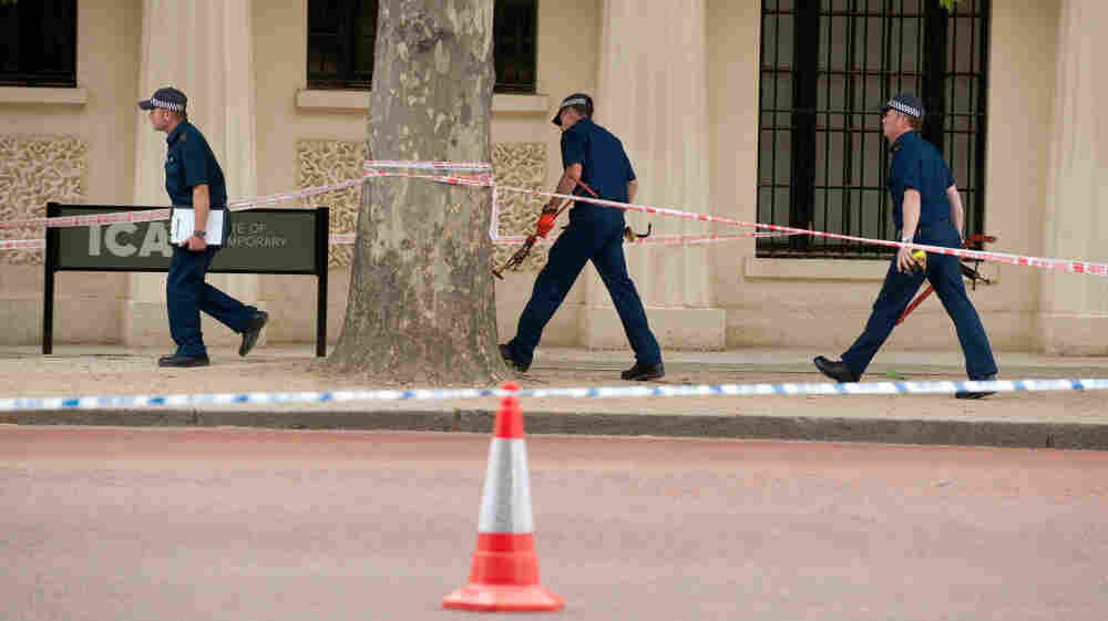 British police prepare to lift manhole covers in central London, on May 16, 2011 following a security alert.