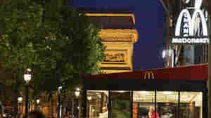 In Paris, the Arc de Triomphe looms over one McDonald's.