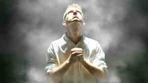 Male looks up in prayer.