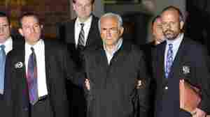 IMF head Dominique Strauss-Kahn is taken out of a New York police station on May 15, 2011.
