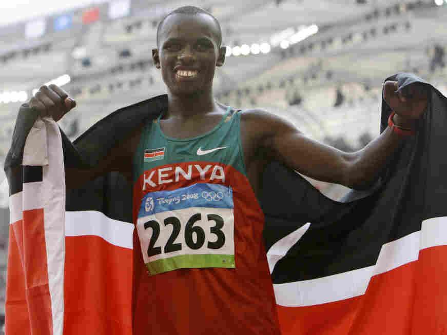 Kenya's Samuel Kamau Wanjiru celebrates winning the gold after the men's marathon at the Beijing 2008 Olympics; Sunday, Aug. 24, 2008.