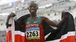 Kenya's Samuel Kamau Wanjiru celebrates winning the gold after the men's marathon at the Beijing 2008 Olympics; Sunday, Aug. 24, 2008.