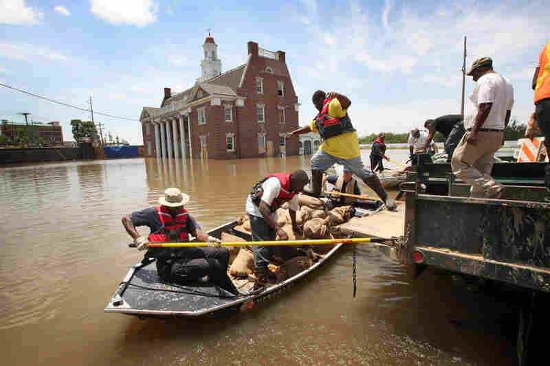 MAY 11: City workers load sandbags for re-enforcing a levee gate onto a boat in Vicksburg. Historic Vicksburg, the site of a pivotal Civil War battle, has been one of the hardest-hit cities.