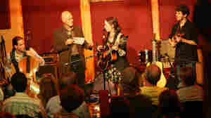 From left, Nathaniel Smith, WFUV's John Platt, Sarah Jarosz and Alex Hargreaves pause during Jarosz's show at The Living Room