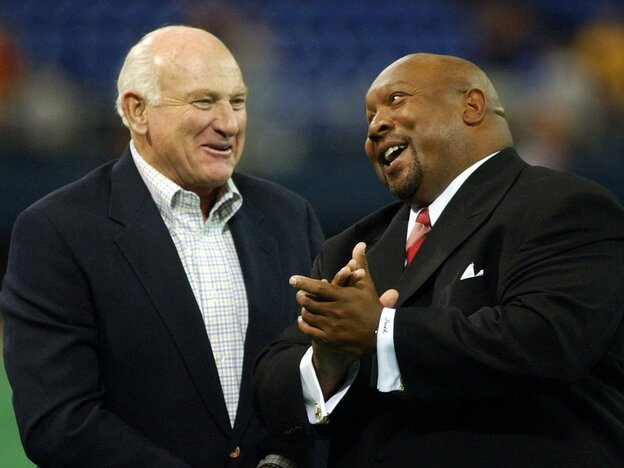 Hall of Famers Harmon Killebrew (left) and Kirby Puckett enjoy a laugh at a 2003 ceremony in Minneapolis.