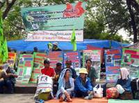 Urban and rural poor from Thailand protest outside government offices in Bangkok. Activists working for slum dwellers have made it harder for developers to obtain land in Thailand without first agreeing with residents on compensation.
