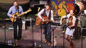 From left, Greg Glassman, David Wax and Suz Slezak perform on Mountain Stage.