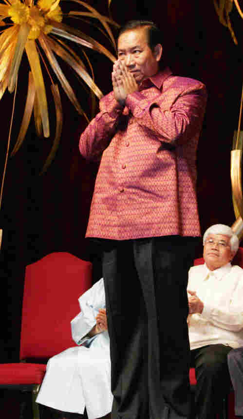 """Ek Sonn Chan of Cambodia accepts the 2006 Ramon Magsaysay Award for Government Service, in Manila, Philippines. Chan was cited for his """"exemplary rehabilitation of a ruined public utility, bringing safe drinking water to a million people in Cambodia's capital city."""""""