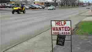 A sign in front of a janitorial service demonstrates the shortage of workers in Aberdeen, S.D.