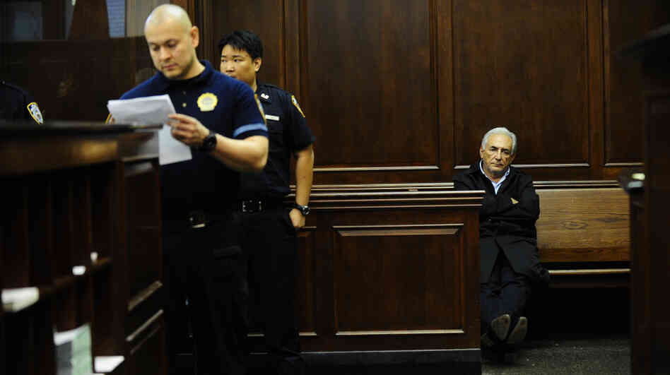 Dominique Strauss-Kahn, the head of the International Monetary Fund, waits to be arraigned Monday in a New York City courtroom.