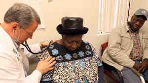 Dr. David Gilder gives Sally Johnson a checkup at the Mallory Community Health Center in Tchula, Miss.